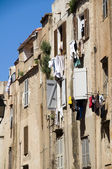 Laundry drying medieval architecture bonifacio corsica — Stock Photo