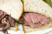 Combination pastrami corned beef on rye sandwich — Stock Photo