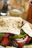 Greek salad with house wine — Stock Photo