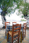 Typical Greek taverna chairs table seaside Antiparos Island — Stock Photo