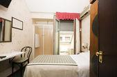 Interior small hotel room milan italy — Stock Photo