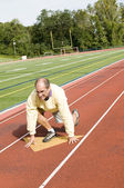 Middle age senior man exercising running on sports field and run — Stock Photo