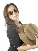 Sexy seductive woman with hat and sunglasses — Stock Photo