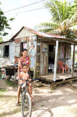 Nicaragua mother daughter bicycle poverty house Corn Island — Stock Photo