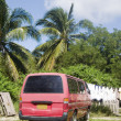 Residential street scene van with laundry hanging palm  trees Clifton Union Island — Stock Photo