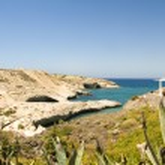 Limestone beach white house architecture Mediterranean Sea Milos Greek Island Cyclades Greece — Stock Photo #23085722