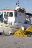 Traditional Greek island fishing boat with nets Milos Greece — Stock Photo