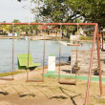 Swing set ride children's park Brig Bay Corn Island — Stock Photo #26987653