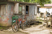Editorial children's bicycles typical native house Corn Island — Stock Photo