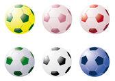 Färgade fotbollar — Stockvektor