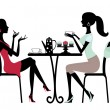 Two beautiful women sitting in a cafe - Stock Vector