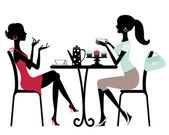 Two beautiful women sitting in a cafe — Stock Vector