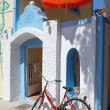 Stock Photo: Greek House with Umbrelland Bicycle