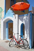 Greek House with Umbrella and Bicycle — Stock Photo