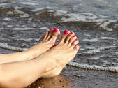 Female Feet on the Beach — Stock Photo