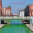 Downtown Indianapolis Canal dyed green for the St Patrick's Day - Stock Photo