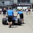 Indy 500 Race Crew Members pushing a Race Car to Gasoline Alley — Stock Photo