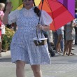 Stock Photo: Person dressed as Dorothy from Wizard of Oz greets at Indy Pride