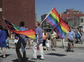 Two Guys walking with Pride flags at Indy Pride — Stock Photo