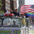 Stock Photo: Colorful Old Decorated Firetruck with Americand Rainbow Flags at Indy Pride