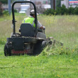 Man mowing  lawn with a ride on lawn mower  — Стоковая фотография