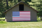 Old Barn with Big American Flag — Stock Photo