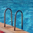 Swimming pool with Metal Ladder — Stock Photo