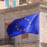 European Flag flying on the flag pole in Symi,Greece — Stock Photo #28853055