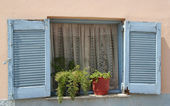 Old Greek Blue Window Shutters with pretty curtains — Stock Photo