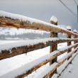 Wooden fence covered by snow — Stock Photo