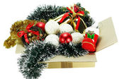 Christmas ornaments in cardboard box — Stock Photo