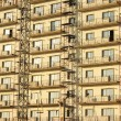 Stock Photo: Building covered by scaffolds