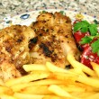 Grilled chicken steak with french fries - Stock Photo