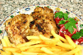 Grilled chicken steak with french fries — Stock Photo