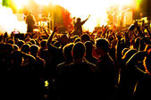 Concert crowd, hands up, toned — Stock Photo