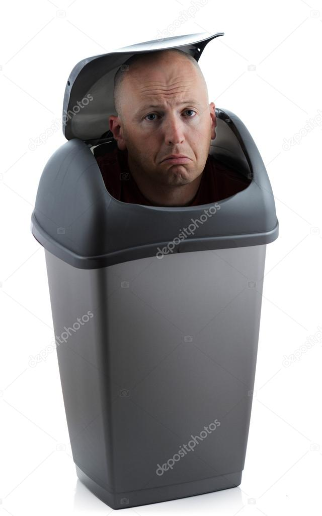 Man in a bin redundant not needed and sad — Stock Photo #13121575