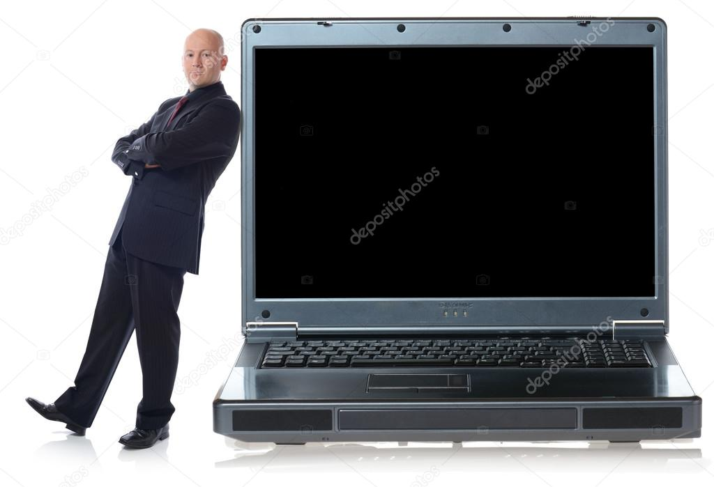 Man in suit leaning agaist laptop isolated on white for copy space — Stock Photo #13124155