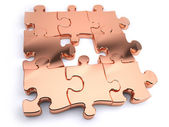 Copper jigsaw — Stock Photo