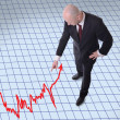 Businessman pointing down to graph — Stock fotografie