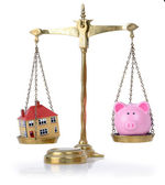 House and bank in balance — Stock Photo