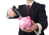 Buisnessman holding bank to ransum with a gun — Stock Photo