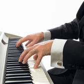 Man in tuxedo playing piano — Stock Photo