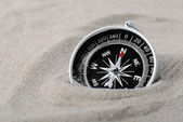 Compass part buried in sand — Stock Photo