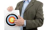 Businessman holding target — Stock Photo