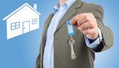 Man offering keys — Stock Photo