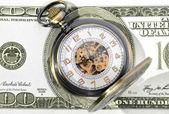 Pocket watch with 100 dollar — Stockfoto