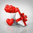 Gift boxes with hearts - Stock Photo