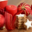 Christmas sweets like cinnamon pastry and lit a candle — Stock Video