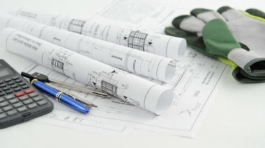 Architectural drawing blueprint with calculator pen and work gloves — Stock Video