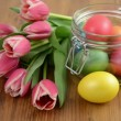 Rack focus on glass jar with bunch of pink tulips and Easter eggs — Stock Video